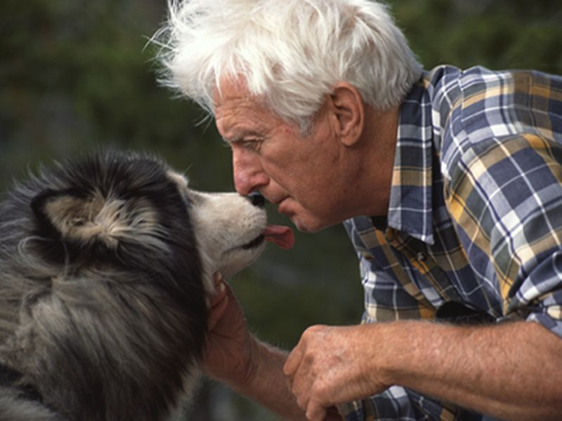 man kissing dog
