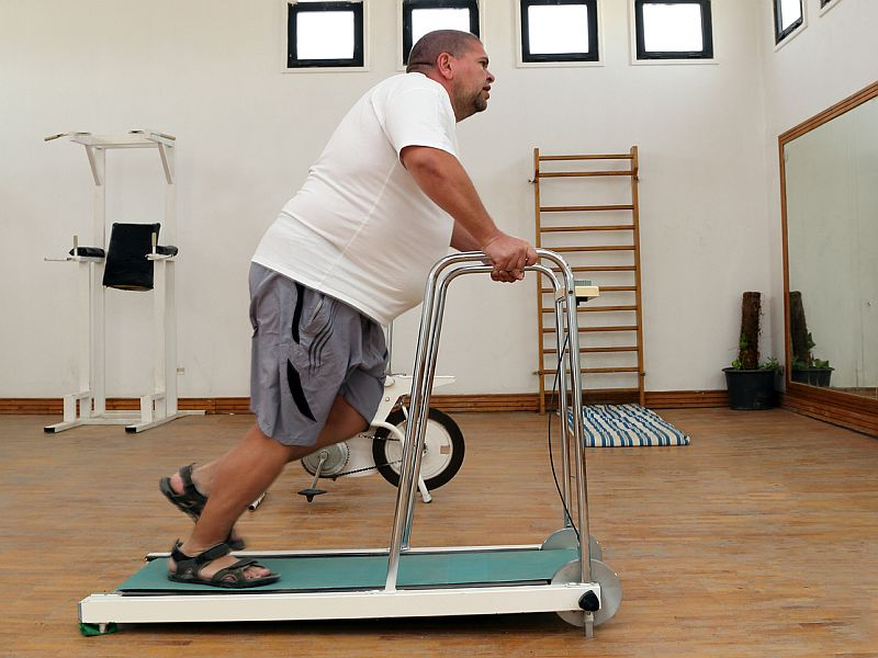 overweight man on treadmill